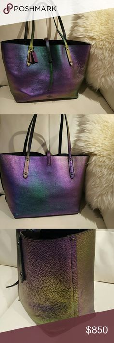 RARE?? Coach Iridescent hologram market tote Coach iridescent hologram market tote. Beautiful pebbled hologram leather gives off many colors including,  purple, blues,greens,pinks, gold and more. Made in 2011, and is now discontinued. Light wear on bag, please refer to photos. Small scuff on lower right side which is very hard to see.  Inside of the bag is very clean. Corners of the bag show signs on use but no marks! Overall Beautiful condition. Please no negative comments.  No trading or…
