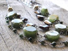 Multi-strand Peridot, Garnet and Turquoise Necklace, Sterling Silver and Green, Blue, Maroon Gemstone Layered Necklace by RachelUngerJewelry on Etsy https://www.etsy.com/listing/239426306/multi-strand-peridot-garnet-and