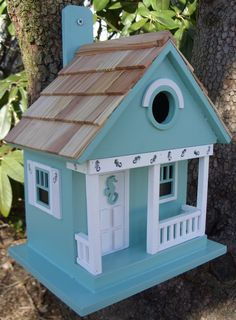 Part of our Beachcomber Collection of whimsical, fully functional birdhouses, the Cottage Birdhouse features a classic motif with &ldquopunched-out&ldquo details along the porch and side window trims. Decorative Bird Houses, Bird Houses Painted, Teal Bird, Bird House Kits, Victorian Cottage, Bird Boxes, Backyard Birds, Fairy Houses, House Painting