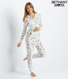 "My Christmas Lights Zip-Up Hooded Onesie is so fun, colorful and festive that it makes me feel like a kid again! It's seriously the coziest thing I've ever owned, and it even has pockets. Never grow up, xoxo Beth<br><br>Relaxed fit. Approx. inseam: 28""<br>Style: 3003. Imported.<br><br>60% cotton, 40% polyester.<br>Machine wash/dry. <br><br>Model height: 5'9.5""; Size: Small."