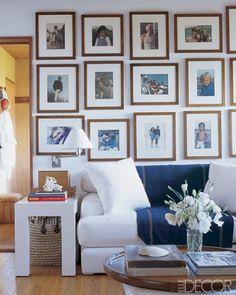 Homeowners Ricky and Ralph Lauren / Photo Pieter Estersohn / From Elle Decor July 2005 / #gallerywall #familyphotos #livingroom