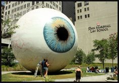 """""""The Eye"""" stands nearly 30 feet tall, and was created by Chicago artist Tony Tasset. It is located at Pritzker Park at South State Street and Van Buren Street."""