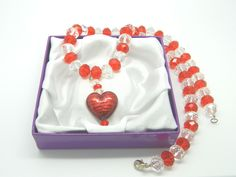 Murano glass strawberry heart pendant necklace with red and clear crystals and sterling silver trigger clasp.  Price £28. #craftfest
