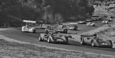 1968 Bridgehampton Can-Am, the field streams through Echo Valley during the pace lap. Not seen are the two McLaren M8A cars on the front row. Peter Revson and Mark Donohue are in front of Hall's Chaparral. Dan Gurney is alongside. Hall would pass the five cars in front of him to take the lead and drive away. Not long after, his car would suffer a fuel injection problem that would reduce power and rob him of a victory. Hall would take 2nd behind Donohue. Tom Burnside photo, repaired.