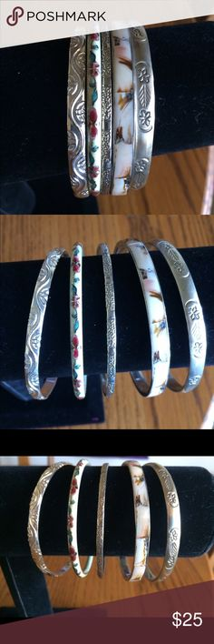 """Bundle of Boho Bangles Bundle of five different Bangles. Left and middle are Silver plate. Right is Brass. Other two appear to be Cloisonné and inlaid shell but I'm not positive about the shell. All are approximately 2-1/2"""" in diameter. I'm selling them AS IS because some have a few nicks and inside scratches. However they're all beautiful especially when worn together for a pretty Boho look. Jewelry Bracelets"""