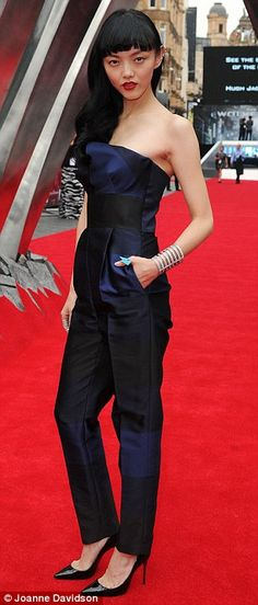 Glam factor: Rila Fukushima, who plays Yukio in the film, looked cute in a navy blue strapless jumpsuit and pointy black heels