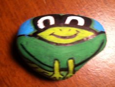 Painted frog on Rock by me