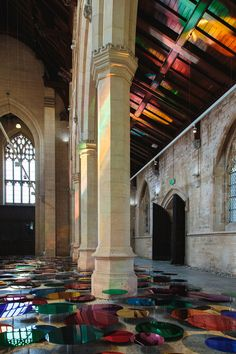 Artist Liz West Fills Church with Hundreds of Coloured Mirrors