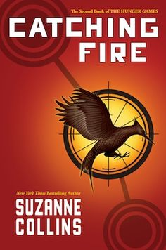 Book Cover: Catching Fire on the book cover there is a mocking jay pin that katniss wears. the color of the book looks like fire and seems like it is burning