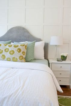 Love the grey velvet headboard with the mint/gold accent colors.