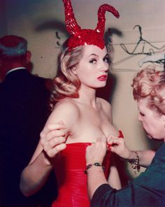 Anita Ekberg being fitted into a devil costume, Hotel Commodore,1955