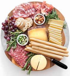 Now THIS is one good-looking cheese board. If we ever bumped into this gorgeous platter at a party, it would be love at first sight. Amanda of Fashionable Hostess breaks down the pieces of this cheese lover's paradise, from salamis