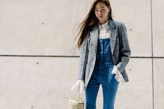 Well fitted overalls and lacy flare sleeves layered under a blazer