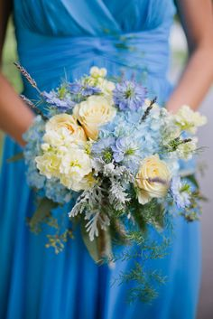 Love these colors! Buttercream yellow stock, baby blue hydrangea, lavender, dusty miller, roses!