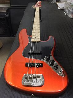 A JB in Tangerine Metallic, black guard, maple neck with Light Tint Satin finish, body color headstock. G&l Guitars, Manchester United Legends, Fender Vintage, Fender Bass, Bass Guitar Lessons, Guitar Collection, Cool Guitar, Satin Finish, Musical Instruments
