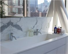 Established favorite, Glacier White Corian® meets luxury in this HL23 Chelsea, NYC residence. Via Sterling Surfaces