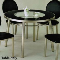 """Round Dining Table with Glass Top in Silver Finish by Acme Furniture. $339.00. Dining and Kitchen. Round Dining Table with Glass Top in Silver Finish. Some assembly may be required. Please see product details.. Dining and Kitchen->Dining Tables. Dimension: 42""""Diameter x 30""""H Finish: Silver, Black Material: Metal, Glass Round Dining Table with Glass Top in Silver Finish Features 8mm black print glass top. Embellish your dining room with the classic beauty of this item. Item will l..."""