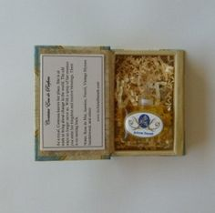 Natural Perfumes in French Flacons in gold foil patterned boxes by JoAnne Bassett