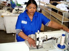 A photo on the topic(s): woman,work,design,sewing,machine,factory