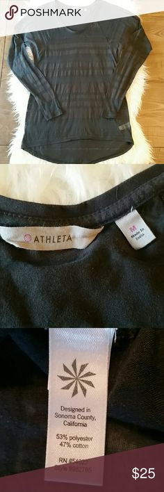 Athleta Shiva Long Sleeve Tee in Black Stripe Perfect long sleeve top to put over your workout tank with yoga pants! You'll be ready to hit the gym, go hiking or for a walk! Athleta black stripe shiva tee with long sleeves. High low, scoop neck.  Size medium. Laying flat measures approximately  Bust 18 inches  Length 28 inches in front, 30 inches in back Athleta Tops Tees - Long Sleeve