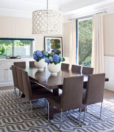 Ten Brown Upholstered Chairs Add A Lively, Fun Note To This Contemporary Family  Dining Room, Which Was Built With Durability And Easy Cleaning In Mind.
