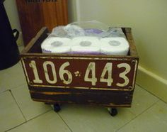vintage licence plate attached to a box for storage. I would use it for something more attractive than TP though