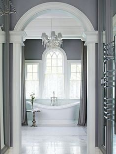 Gorgeous bathroom details…gray walls, white tub….