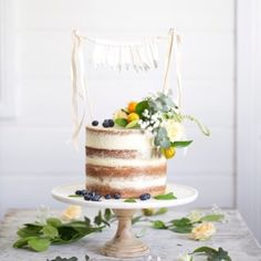 Jen, Bake down cakery. On the weekend I made this semi-naked cake for Lyn of @inallthingsbeautiful to take to @thecottagekangaroovalley. Having collaborated with her before I knew she would style it beautifully! Here's the result, using her gorgeous handmade bunting, rustic fresh flowers and marble cake stand from @williamssonomaaus! Keep your eyes peeled for Lyn's creative workshops debuting in Spring!