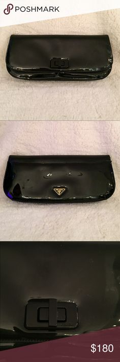 PRADA Black Patente Leather Purse/Clutch/Pochette Black patent leather Prada clutch bought at Neiman Marcus in Beverly Hills in 2012. Used only a few times.  Two minor condition issues, one to back pocket, one to front edge.  Otherwise, great condition -please see photographs. Includes authenticity and product information cards.. Front flap secured with black logo turn clasp, back of bag has useful pocket and Prada triangle logo. Interior has two pockets (one w/zipper, and a tiny white tag…