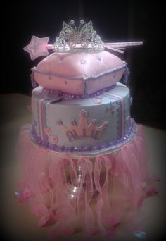 """Princess Pillow - Pillow is a fondant covered 8x8 (carved).   Bottom tier is a 10"""" butter cream cake with fondant accents.   I hate that I didn't take more pictures.    There are lots of hearts and butterflies all around the cake."""