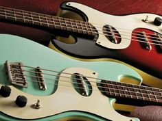 a pair of danelectro dano 63 basses  i have the beautiful aqua one!