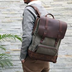The Otto Backpack is the perfect handsome companion for your everyday commute. Crafted from durable waxed canvas and upcycled genuine leather. The bag includes a padded laptop sleeve functional interi