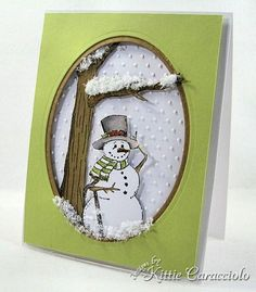 handmade winter card ... cool green background ... negative oval window frame matted in brown ... adorable snowman image .. luv the Flower Soft piled on tree branch and bottom of oval ... delightful!