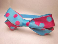 Polka dot bow headband by SewVivid on Etsy, £5.00