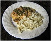 Chicken with mushrooms and wine, along with hot cooked noodles.  With dried TARRAGON and 1c. Ch. broth and wine.