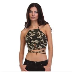 Military Print Crop Top  Military print crop top. Super cute to wear for the warmer weather coming up! 100% cotton! Can be worn just like model is wearing it! ❤️ (pictures courtesy of tea n cup) Tea n Cup Tops Crop Tops