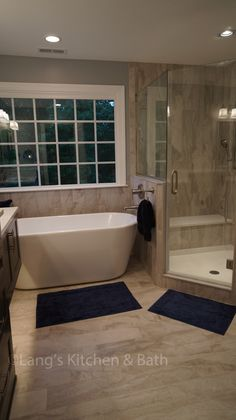 This transitional style bathroom design offers a soothing retreat with elegant design details. The angled shower features a custom storage niche and corner storage shelf, and the freestanding tub…More Bathroom Layout, Bathroom Interior, Modern Bathroom, Bathroom Ideas, Master Bathrooms, Bathroom Showers, Warm Bathroom, Bathroom Organization, Bathroom Cabinets