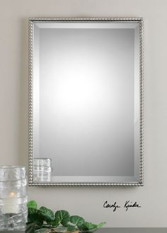 """Brushed nickel mirror, metal frame features a decorative beading design. Mirror features a generous 1 1/4"""" bevel. May be hung either horizontal or vertical. Item #01113 http://www.decorbound.com/store/#!/Sherise-Brushed-Nickle-Mirror/p/40889237/category=10288420"""