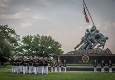 The 18th Sergeant Major of the Marine Corps, Ronald L. Green, hosts a Sunset Parade at the Marine Corps War Memorial, Arlington, VA, June 28, 2016 with performances from the Marine Drum and Bugle Corps and the Silent Drill Platoon.