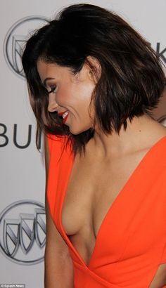 Peek-a-boo: Jenna Dewan Tatum offered a cheekyglimpse of cleavage in a plunging tangerine pencil dress as sheled the glamour at the Buick 24 Hours of Happiness Test Drive launch event in Los Angeles on Wednesday