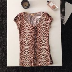 Zara top Cheetah patterned t-shirt from Zara.Soft and stretchy.fitted. Zara Tops Tees - Short Sleeve