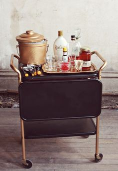 The Bar Cart is Back coined @SocietySocial and we agree. This two level trolley has an upper shelf which folds down in half when in transport. More compact moving around your home and then extends for extra counter top area when entertaining.