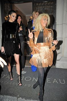 Enviable figure: As she walked behind her sibling, Kendall gave another glimpse at her leg...