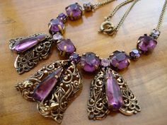 Art Deco Necklace Amethyst Glass and Filigree 1920s 1930s. Great mix of antique metal and Amethyst Glass stones. Could be best for the full Jeweltone figure.
