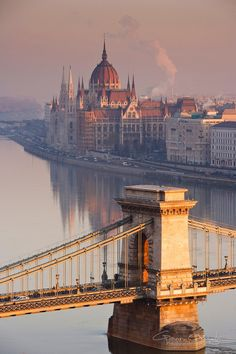 Sunrise over the Szechenyi Chain Bridge and Hungarian Parliament Building beside the river Danube in Budapest, Hungary