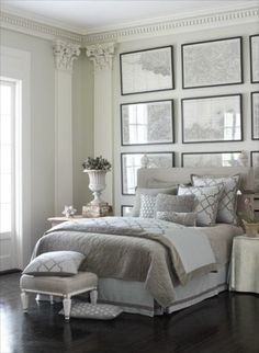 This bedroom has wonderful classic architectural details. The floors are stained dark and even without a small area rug seems finished. Even if you take away the pilasters in the corners this room would not have the sophistication without the wall of framed maps above the bed. They balance out the height of the rooms walls, and the simple thin frames knock it up a bit. Notice that the frames even extend below the level of the mattress.