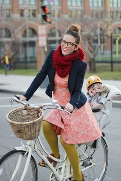 What a stylish mama! Naomi Davis, blogger at Rockstar Diaries, rides a bike with her gorgeous daughter Eleanor.