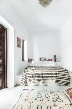 The bedroom of our bohemian dreams. Get the look with a kilim rug.