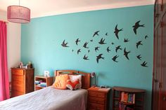 Add drama to a blank wall by filling it with a lively group of swallows, mid-flight. Get the tutorial (and download a template) at Curly Made »  - GoodHousekeeping.com