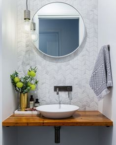 """STUDIO BLACK INTERIORS (@studioblackinteriors) posted on Instagram: """"It may only be small, but this hardworking little space is the room that sees a lot of action when you have family and friends over. This…"""" • Jun 22, 2020 at 7:38pm UTC Powder Room Vanity, Powder Room Decor, Powder Room Design, Powder Room Lighting, Tuile Chevron, Chevron Tile, Herringbone Tile, White Bathroom, Bathroom Interior"""